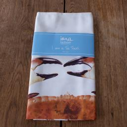 tea towel with crab design in packaging