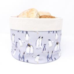 A bread warmer featuring a parade of penguins