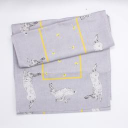 Table runner with hare and dandelion design - folded