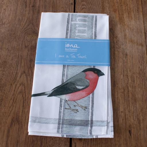 tea towel with bullfinch design in packaging