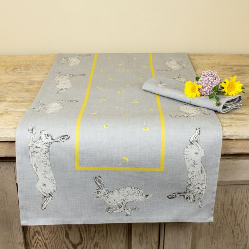 Table runner with hare and dandelion design