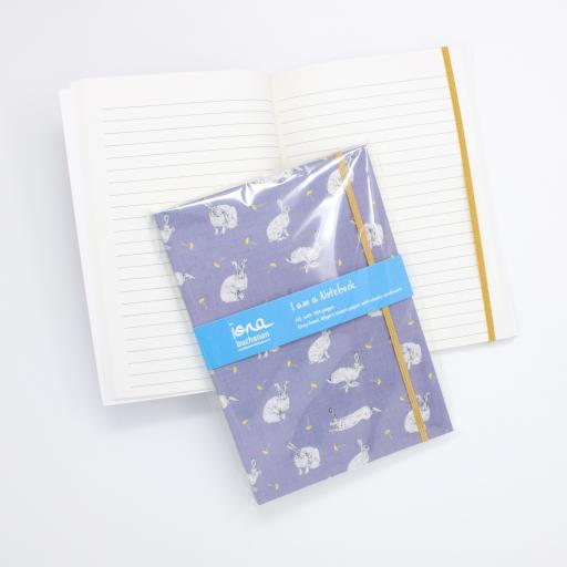 A notebook with elasticated enclosure with a hare and dandelion design showing open pages