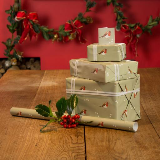 A selection of presents wrapped in a Robin & Mistletoe design wrapping paper